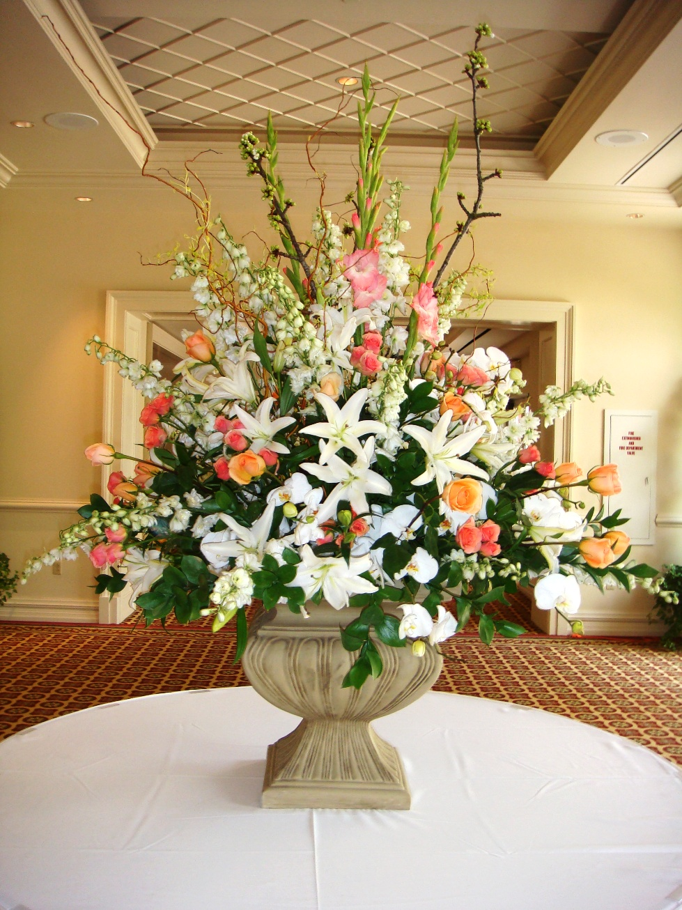 floral pedestal large floral arrangement in stone pedestal container the wedding flowers. Black Bedroom Furniture Sets. Home Design Ideas